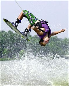I love to wakeboard! This flip is called a tatrum and I'm learning how to do it! I can almost land it... almost.