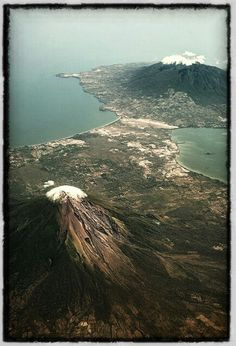 aerial photo of Ometepe Island, NICARAGUA, and the two volcanoes of Concepcion and Maderas. Ometepe Island is surrounded by Lake Nicaragua and is an incredible eco / nature paradise. Volcan concepcion!   - Explore the World with Travel Nerd Nici, one Country at a Time. http://TravelNerdNici.com