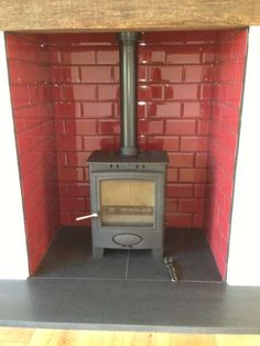 Wood burner.  Tiled inset - slate hearth (love the enamel look brick)