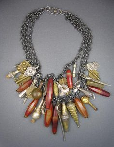Another fun charm necklace made of beads and artifacts from around the  world, from many different eras. Antique pieces and parts from Ethiopia,  Nigeria, Morocco, and Afghanistan, on strands of Thai silver chain.  http://dorjedesigns.com/