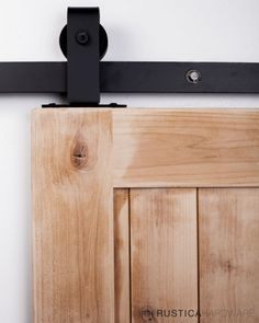 pDesigned for mounting to the top of the door verses the face of the door, this Modern Industrial style allows for the functionality of rolling barn door hardware without the traditional face mounted installation. Characterized by its metal hanger strap…/p - http://RusticaHardware.com/