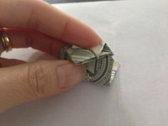 Insert the very tip into the slot. Note-the tips won't stay put because its so little. Dollar Heart Origami, Easy Dollar Bill Origami, Origami Heart, Money Lei, Money Origami, Folding Money, Diy Envelope, Oragami, Diy Paper