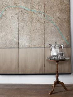 A three-panel screen, wallpapered with a 1930s Paris map, decorates the entry. The engraved silver coffee set dates from the 1940s.