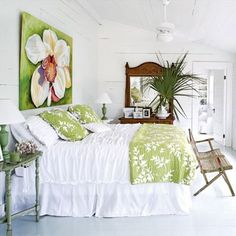 Love this bright white bedroom with lime green accents.