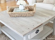 Jen at City Farmhouse gave an IKEA coffee table a touch of rustic by adding a faux barn wood surface to the top, great texture!