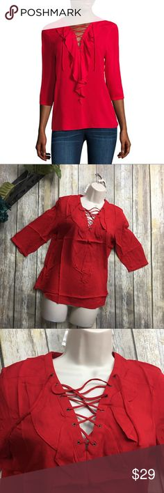 A.n.a Red Lace Up Blouse Red lace up Blouse. New with tags. Size PM . Light soft beautiful comfortable material. 100% Rayon. Flattering neck line! 3/4 sleeves. 24 inches long in the front and 26 inches long in the back. 18 inch bust line laying flat without being stretched. a.n.a Tops Blouses