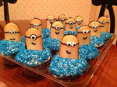 #Minion Cupcakes from Despicable Me. We used Milano cookies for the minions. and a denser cupcake recipe so the minions would stay up straight.