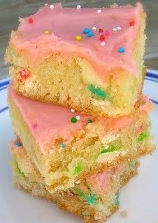 Cake Batter Blondies Recipe      Ingredients:  1 box yellow (or Funfetti!) cake mix  1/4 cup vegetable oil  1 egg  1/3 – 1/2 cup milk  1/4 cup rainbow sprinkles (if you use a yellow cake mix, add these in)  1/2 cup white chocolate chips   Sprinkles for the top  Frosting (see recipe below)  Directions: Combine the cake mix, oil, and egg in a large
