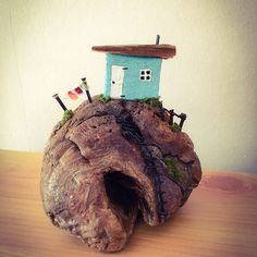 """The joy of my little DownTime project is the people I come to meet because of what I do. This is a commission from a lovely customer who plans to move to the Isle of #Mull. She specifically wanted a house on driftwood with a #cave because her soon-to-be home sits above a cave. I had just the piece. :-). She has given it a gaelic name: """"Taigh faisg air an uaimh"""", which means, 'cottage near the cave', appropriately enough. I wish her all the best on that wonderful, wonderful island which…"""