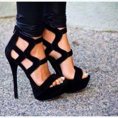 high, high black heels.