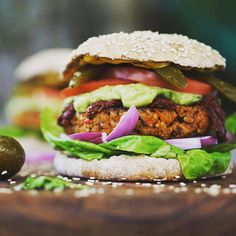 Vegan Food Lovers Features Protein Packed Veggie Burger  By @mangoychile  What you need Serves 12 good sized burgers  1 cup brown rice (makes 3  cups cooked) 1 cup toasted cashews 1/2 cup sunflower seeds 1/4 cup whole flax seeds 1/2 red onion 2 cloves garlic minced 1 cup finely chopped celery 2 cups finely chopped parsley 1 medium sized plantain 3 Tbs achiote (annatto) paste or 2 Tbsp paprika   tsp of nutmeg 2 Tbs tapioca powder 1 1/2 cups oatmeal flour 4 tsps sea salt Safflower or avocado…