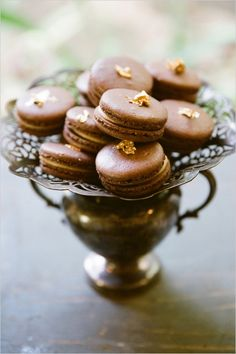 chocolate macarons with gold leaf
