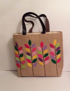 Jute tote bag hand appliqued with colorful branches handmade summer tote bag shoppers beach bag 2019 Colorful leaves branches handmade jute tote bagsummer tote Jute Tote Bags, Canvas Tote Bags, Hand Applique, Hand Embroidery, Summer Tote Bags, Painted Bags, Applique Designs, Handmade Bags, Felt Crafts