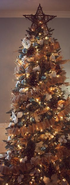Our Christmas tree 2012.  Made burlap garland via Pinterest site and filled with pine cones, cotton and corn husks.  I love the finished product!