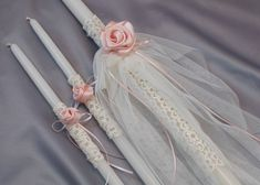Our Nadia Girls Baptismal Candles-Lambathes -Wrapped in European lace with handmade satin flowers and English tulle -Baptismal candle set includes one 24 lambatha and two 17 candles -Choose the set in soft white or white lace -Contact our shop for the full baptismal set including