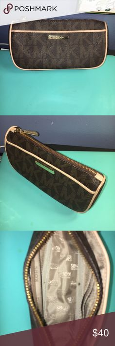 Authentic brown Michael kors cosmetic case Rarely used cosmetic case. 3rd picture depicts only flaw. Michael Kors Bags Cosmetic Bags & Cases