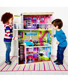 La Belle Maison Wooden Dolls' House. Luxury home complete with gorgeous furniture to play with.