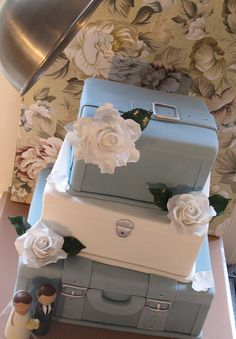 @KatieSheaDesign Likes--> #Cake A pile of suitcases  This cake was made for a couple getting married