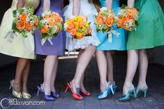 Love the mixed bridesmaid colors... with the matching bouquets!