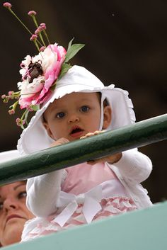 This may have been the cutest fan at Churchill Downs. Who wants to bet she grows up to love horses?