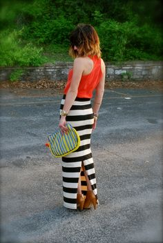black and white stripe maxi skirt and beaded clutch