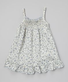 Take a look at this Ivory & Blue Floral Shirred Dress - Infant, Toddler & Girls on zulily today!