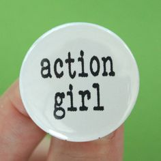 SHIPS 7 JULY action girl.  1.25 inch button. because you get things done, and that makes you awesome. $1.40, via Etsy.