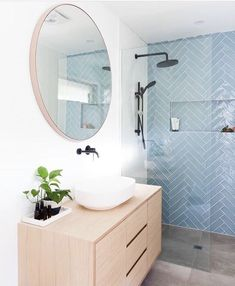 An updated, feminine bathroom idea. Herringbone shower tile in a peaceful aqua contrasts nicely with the round mirror and light wood vanity. So stylish! Laundry In Bathroom, Small Bathroom, Feminine Bathroom, Guys Bathroom, Bathroom Plants, Bathroom Interior Design, Modern Bathroom Design, Bath Design, Beautiful Bathrooms