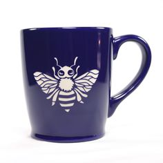 Honey bees make the world go 'round! Apiculture (beekeeping) isn't for everyone, but these mugs are great for insect lovers and tea drinkers. This large, sturdy coffee mug comes in tangerine orange, n