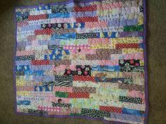 Scrap baby girl quilt