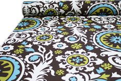 """54"""" wide100% 10 oz cotton duck   A stunning, over sized, """"Suzani"""" type print in chocolate brown and pool blue with chartreuse yellow-green contrasted by an unbleached natural cream.   Pattern repeat is large, measuring 51"""" horizontal by 24"""" vertical.  Made of 100% cotton, medium weight canvas or """"duck"""" cotton (10 oz per yard or 300 grams)."""