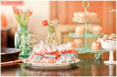 Very pretty aqua and orange baby shower.  So cute!! The party favors were animal crackers dipped in those same colors.  Love it!