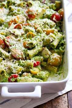 This Healthy Baked Pesto Rigatoni is tossed with heirloom tomatoes and a saucy spinach pesto that will knock your socks off! 340 calories.