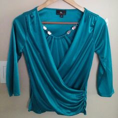 ☄NWOT Turq 3/4 sleeve Top w/ Jewels☄ Brand New, Never Worn. Pretty Turquoise 3/4 sleeve Top with Silver Jewel accents in front. Size Small. Tops Blouses