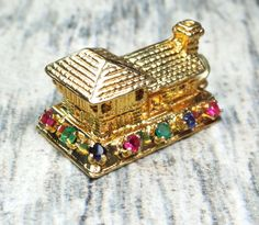 This Vintage 14k Gold House Charm is fabulous! The 14k yellow gold house has wonderful detail on all sides. There are doors, open work windows..