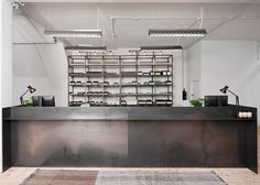 Philippe Malouin's studio Post-Office has used a minimal colour palette and custom-designed furniture to turn a warehouse into Aesop's UK head office