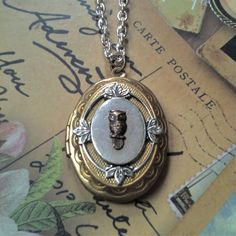 I own this and I LOVE it!  These are made by a friend I went to college with!  She is so talented.  Check her out!!!  Victorian-Inspired owl locket  www.ellepaisley.etsy.com