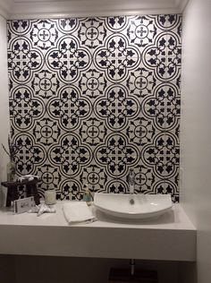 TILE DESIGN: Avente Tile's Traditional Bayahibe C Polished Cement Tile graces the wall of this powder room. Many thanks to our client for sharing the post-installation image!