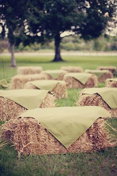 Bales of hay are the perfect ceremony seating for rustic backyard wedding on the farm.