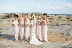 Adrietta Dress By Samantha Rose on SALE at  $120.00   A gorgeous tulip shaped bridesmaid dress by Samantha Rose. A strapless style featuring ruching on the bust and a wrap style skirt.