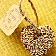 """Bird seed favor, how fun would it be to take it home and watch all sorts of birds come eat it lol, and the note could say, """"thanks for celebrating with the love birds!"""" or something cheesey like that...."""