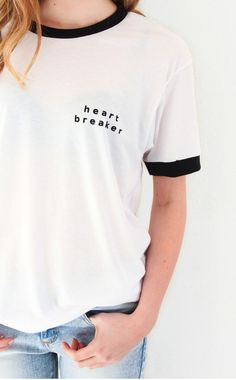 "- Description - Size Guide Details: Super cute & soft unisex white ringer tee with print featuring 'Heart Breaker' on front left chest. Brand: NYCT Clothing. 50% Cotton, 50% Polyester. Sizing: 40"" / 1"