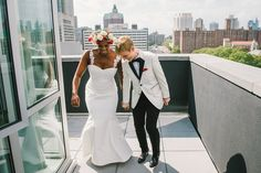 These lovebirds were too busy jumping for joy to be concerned with how dashing they look: | 16 Dapper Brides Who Said No To A Dress