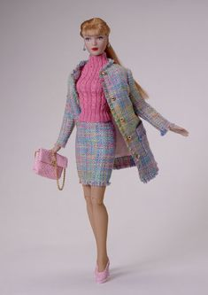 Suitably Spring (2003) OUTFIT ONLY TW 8303 LE 1500 $79.99 Note: Prototype doll as shown is not currently available. Tyler Wentworth® knows colors and uses them to their best advantage in suit ensembles. Working with a noted sweater maker, Tyler combined a cable-knit pink with the effect of tweed and pastel colors to create a stunning hand-fringed suit. Faux pink embossed leather was one of the season splashiest examples of Tyler's amazing accessorizing abilities.
