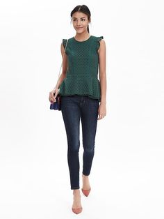 A ruffled trim makes our floral lace peplum top oh-so feminine. Style this flirty dark green shirt with your favorite pair of dark jeans and coral pumps for a chic spring outfit | Banana Republic