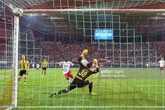 Naby Deco Keita of Leipzig scores the first goal against Roman Buerki, keeper of Dortmund during the Bundesliga match between RB Leipzig and Borussia Dortmund at Red Bull Arena on September 10, 2016 in Leipzig, Germany.