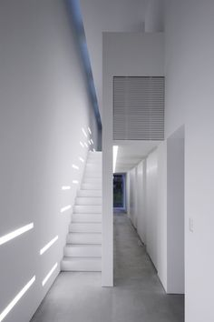 All-white interior design, corridor with clean lines _ via Jam _