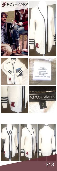 """🎓Almost Famous Collegiate Open Cardigan Sweater🎓 🎓Almost Famous Collegiate Open White Cardigan Sweater🎓 letter A in red contrast. Black trim. Size small but can fit up to a size medium. Measurements are; armpit to armpit 20"""", length 30"""" and sleeve measured from back mid seam of neck is 33"""". In excellent condition. All my items are from a smoke free environment. Almost Famous Sweaters Cardigans"""