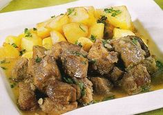 Rojões - Easy Portuguese Recipes 4.5 pounds pork shoulder (with the fat), cubed  2 teaspoons cumin  2 tablespoons olive oil  6 garlic cloves, chopped  2 bay leaves  2 teaspoons salt  1 teaspoon black pepper  1 bottle Portuguese white wine  1 pound potatoes, chopped  2 teaspoons parsley, chopped