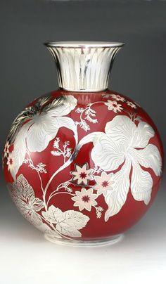 c1939 rosenthal porcelain vase with hallmarked silver floral overlay